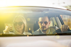 Couple driving a new car Stock Photography