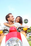 Couple driving scooter in love Royalty Free Stock Images