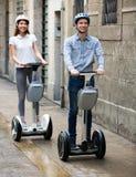 Couple driving segways Royalty Free Stock Photo