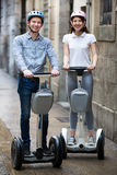 Couple driving segways Stock Photography
