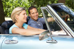 Couple driving sports car Royalty Free Stock Photos