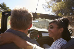 Couple driving, woman looking at man, close up back view Stock Photography