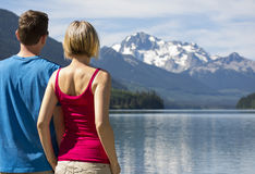 Couple at Duffey Lake in a summer Royalty Free Stock Image
