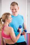 Couple with dumbbells Stock Images
