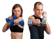 Couple with dumbells and attitude. Young, caucasian couple doing boxercise with dumbells Royalty Free Stock Photography