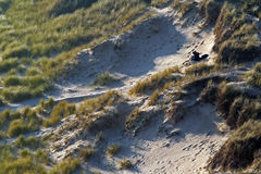 Couple in the dunes. Secluded spot in the dunes stock image