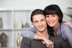 Couple at ease together. Young couple at ease together at home royalty free stock images