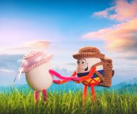 A couple of Easter egg hikers in a funny hats with backpacks royalty free stock images