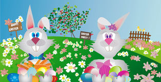 Couple of easter rabbit with painted easter eggs in outdoor Stock Photography