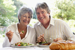 Couple Eating An Al Fresco Meal Stock Photography