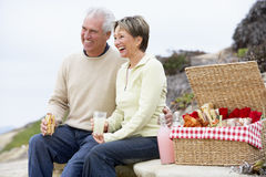 Couple Eating An Al Fresco Meal At The Beach Stock Photos