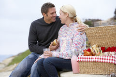 Couple Eating An Al Fresco Meal At The Beach Stock Image