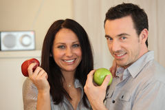 Couple eating apples Stock Photo