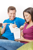 Couple eating Asian food. Stock Photography
