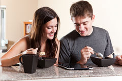 Couple eating breakfast Stock Photos