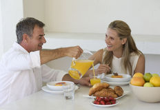 A couple eating breakfast Royalty Free Stock Photos