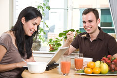 Couple eating breakfast Royalty Free Stock Images