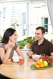 Couple eating breakfast Stock Images