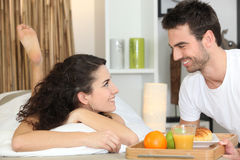 Couple eating breakfast in bed Stock Photo