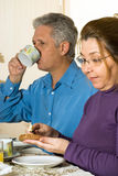 Couple Eating Breakfast - vertical Royalty Free Stock Images