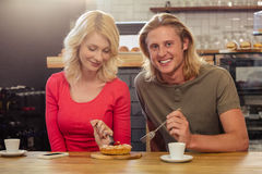 Couple eating a cake togheter Stock Photo