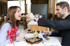 Couple eating can of snails in the restaurant. Royalty Free Stock Photos