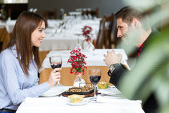 Couple eating can of snails in the restaurant. Stock Images