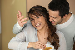 Couple eating cereal Royalty Free Stock Images