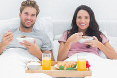 Couple eating cereal during a romantic breakfast Stock Photography