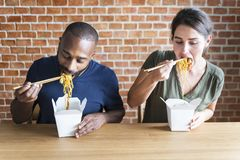 Couple eating Chow mein together royalty free stock photo