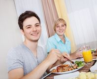 Couple eating a cold lunch Stock Photos