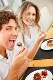 Couple eating dessert Royalty Free Stock Photos