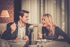 Couple eating dessert. In a restaurant Stock Image