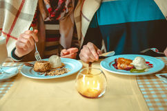 Couple eating dessert in a restaurant Stock Photography
