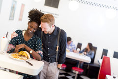 Couple eating in diner Royalty Free Stock Photography