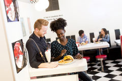 Couple eating in diner Stock Images