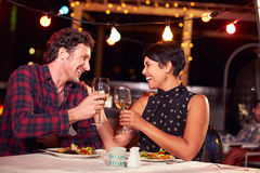 Couple eating dinner at rooftop restuarant Royalty Free Stock Photos