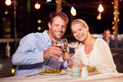 Couple eating dinner at rooftop restuarant Stock Photo