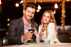 Couple eating dinner at rooftop restuarant Stock Image