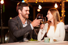 Couple eating dinner at rooftop restuarant Royalty Free Stock Photo