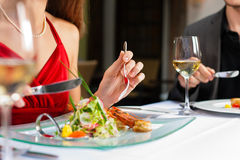 Couple eating dinner in very good restaurant. Couple for romantic Dinner or lunch in a gourmet restaurant drinking white wine and having great food