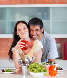 Couple eating and drinking in the kitchen Stock Image