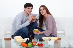 Couple eating fast food Stock Image