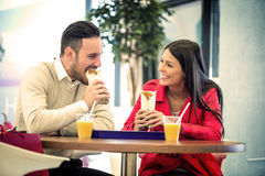Couple eating in fast food restaurant Stock Photo