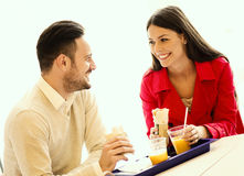 Couple eating in fast food restaurant Royalty Free Stock Images