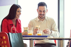 Couple eating in fast food restaurant Stock Image
