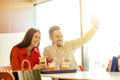 Couple eating in fast food restaurant Stock Photos