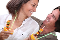 Couple eating fruit royalty free stock photography