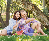 Couple eating fruits in the park Royalty Free Stock Image