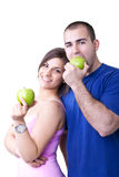 Couple eating healthy  apples Stock Images